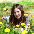 Young girl among the flowers — Stock Photo