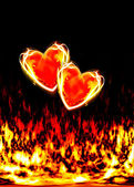 Two loving hearts, burning in the flames of love — Stock Photo