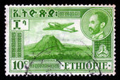 Emperor Haile Selassie and plane Douglas DC-3 over Zoquala Volcano — Stock Photo