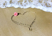 Drawing a heart with rose and sea — Stock Photo