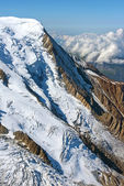 Mountain peak covered with snow — Stock Photo