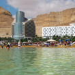 Постер, плакат: Tourists bathe in the Dead Sea Israel