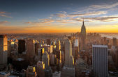 Sunset over new york city — Stock Photo