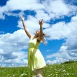 Happy girl in yellow dress — Stockfoto