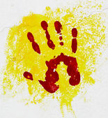 Red palm on the yellow background. — Stock Photo