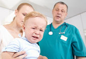Boy is frightened and crying in a medical study. — Stock Photo