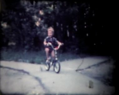 Boy on bike, vintage 8mm film footage. — Stock video