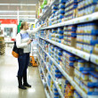 Woman in the supermarket. Kid's food. — Stock Photo #16215911