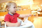 Little boy in the restaurant. — Stock Photo