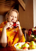 Young woman is drinking tea. — Stock Photo