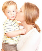 Young happy mother is kissing her child. — Stock Photo
