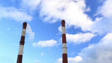Two factory chimneys and blue sky. — Stock Video