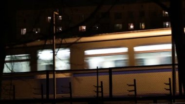 Metro subway train outdoors at night. — Stock Video