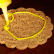 Royalty-Free Stock Photo: Drawing on ginger cookies.