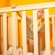 Royalty-Free Stock Photo: Little boy stands in bed