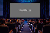 Empty cinema screen with audience. — Stock Photo