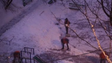 Street cleaners in orange uniform removing the snow — Wideo stockowe