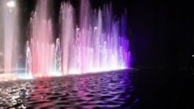 Colorful fountain and water surface — Stock Video