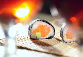 Sushi rolls and plum wine. — Stock Photo