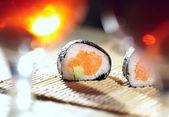 Sushi rolls and plum wine. — Stock Photo