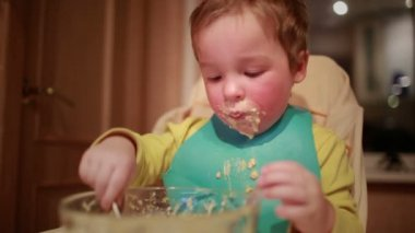 Two year old boy is having dinner independently. — Stock Video