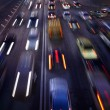 Car traffic at night. Motion blurred background. — Stock Photo
