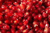 Pomegranate red seed texture background — Stock Photo