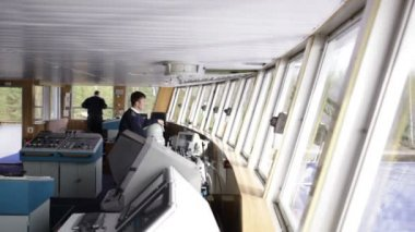SAINT-PETERSBURG - May 11: Navigation officer driving the cruise liner on the river on May 11, 2013 in Saint-Petersburg, Russia. — Stock Video