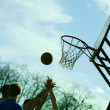 Playing basketball outdoors — Stock Photo