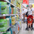 Mother with her boy in the supermarket — Stock Photo #27149761