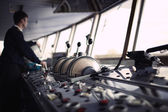 Navigation officer driving ship on the river. — Stock Photo