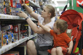 Mother and son shopping for toys — Stock Photo