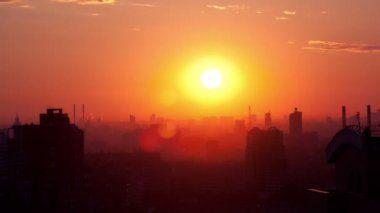 Sunrise over the city. Time lapse. High angle. Aerial view. The roofs of the houses lit by soft warm light — Stock Video