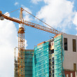 Stock Photo: Crane and construction site.