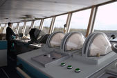 Navigational officer driving ship on the river. — Stock Photo