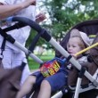 Grandmother walking with her grandson in a baby stroller — Stock Video #28696131