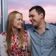 Young couple on the balcony looking to each other — Stock Photo