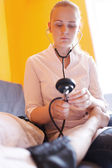 Nurse with stethoscope - blood pressure — Stock Photo