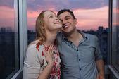 Young happy couple on the balcony — Stock Photo