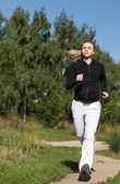 Girl running in the park. Wide shot — Stock Photo