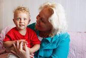 Happy grandmother with her little grandson. — Stock Photo