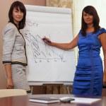 Businesswoman giving a presentation — Stock Photo
