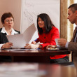 Businesspeople having a meeting over coffee — Stock Photo
