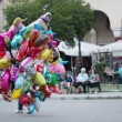 Balloon seller with colourful hydrogen filled party balloons — Stock Video #33440655