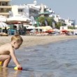 Adorable little boy playing in the sea — Stock Video