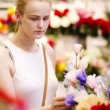 Beautiful young lady buying fresh flowers in store — Stock Video #34193011