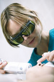 Doctor doing a fractional skin laser treatment — Stock Photo