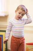 Cute little boy with a puzzled expression — Stock Photo