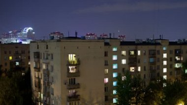 Time lapse of multistorey buildings with changing window lighting at night and following closing-up — Stock Video