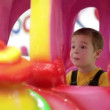 Stock Video: Cute little boy in fairground